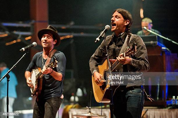 Scott Avett and Seth Avett performing with the 'Avett Brothers' at Red Rocks Amplitheater in Morrison Colorado on July 11 2014