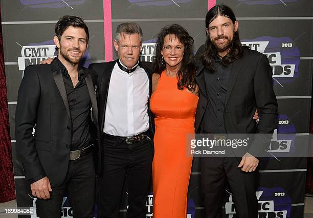 Scott Avett Randy Travis Mary Beougher and Seth Avett attend the 2013 CMT Music awards at the Bridgestone Arena on June 5 2013 in Nashville Tennessee