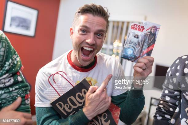 Scott Bailey displays his Secret Santa gift at The Bay Ugly Sweater And Secret Santa Christmas Party at Private Residence on December 12 2017 in Los...
