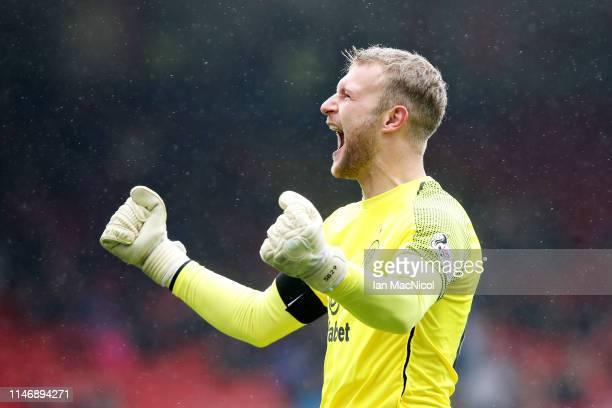 Scott Bain of Celtic celebrates his sides second goal during the Ladbrokes Scottish Premiership match between Aberdeen and Celtic at Pittodrie...