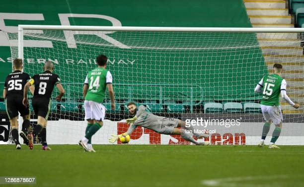 Scott Bain of Celtic saves a penalty from Kevin Nisbet of Hibernian during the Ladbrokes Scottish Premiership match between Hibernian and Celtic at...