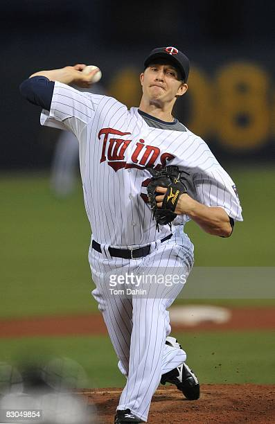 Scott Baker of the Minnesota Twins delivers a pitch during an MLB game against the Chicago White Sox at the Hubert H. Humphrey Metrodome, September...