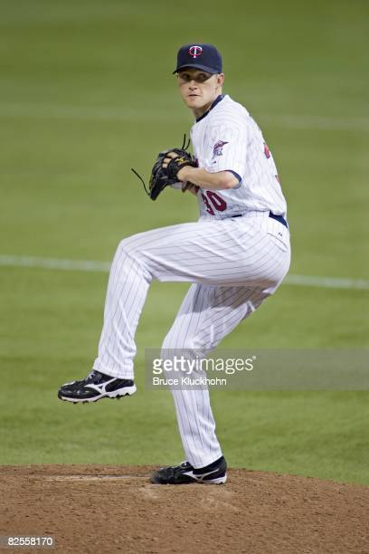 Scott Baker of the Minnesota Twins pitches against the Seattle Mariners at the Humphrey Metrodome in Minneapolis Minnesota on August 16 2008 The...