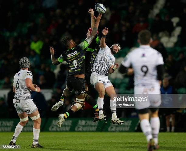 Scott Baldwin of Ospreys Courtney Lawes of Northampton Saints and Christian Day of Northampton Saints during the European Rugby Champions Cup match...
