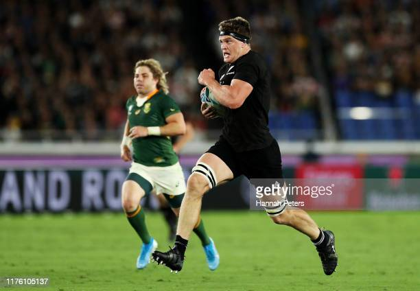 Scott Barrett of New Zealand runs with the ball to score his side's second try during the Rugby World Cup 2019 Group B game between New Zealand and...