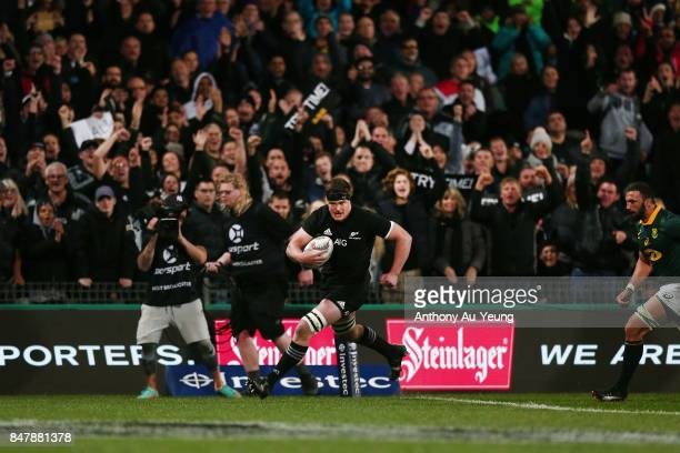 Scott Barrett of the All Blacks runs in a try during the Rugby Championship match between the New Zealand All Blacks and the South African Springboks...