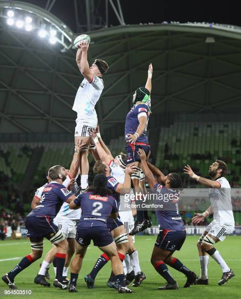 Scott Barrett of the Crusaders and Adam Coleman of the Rebels compete for the ball during the round 12 Super Rugby match between the Rebels and the...