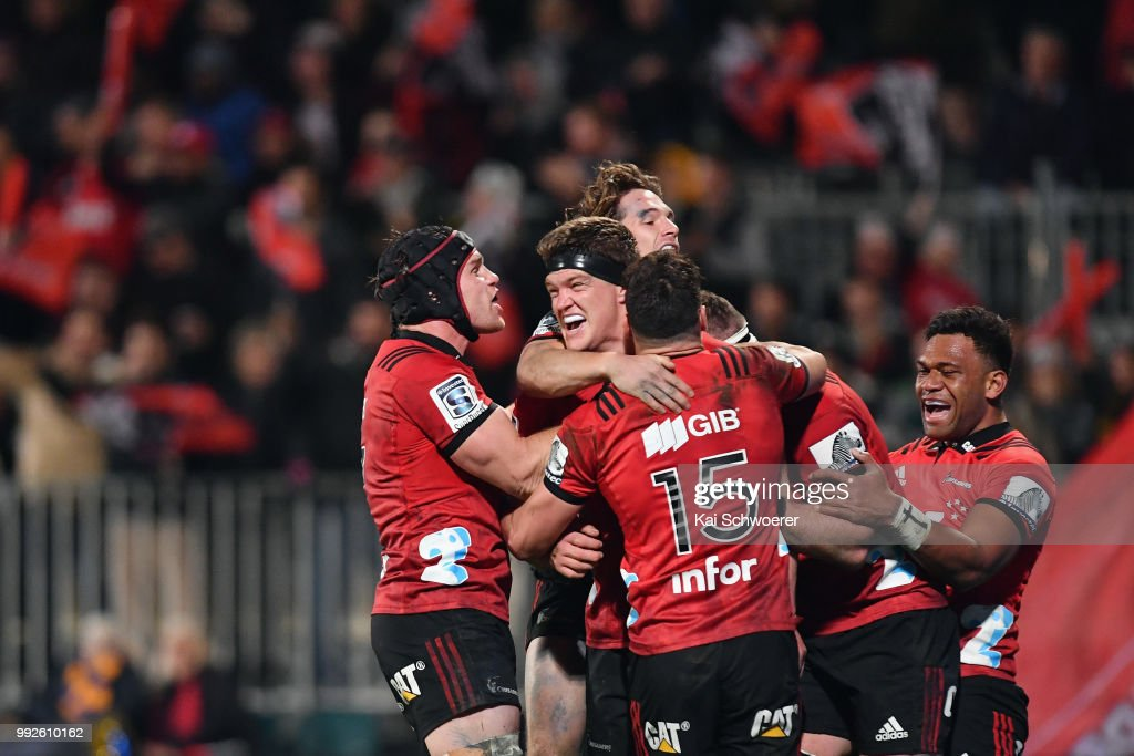 Scott Barrett of the Crusaders (C) is congratulated by team mates after scoring a try during the round 18 Super Rugby match between the Crusaders and the Highlanders at AMI Stadium on July 6, 2018 in Christchurch, New Zealand.