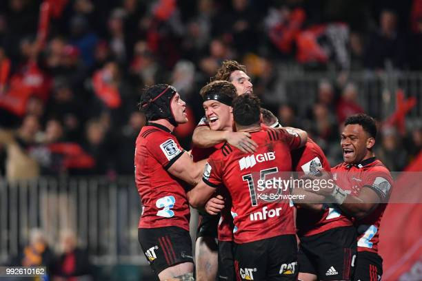 Scott Barrett of the Crusaders is congratulated by team mates after scoring a try during the round 18 Super Rugby match between the Crusaders and the...