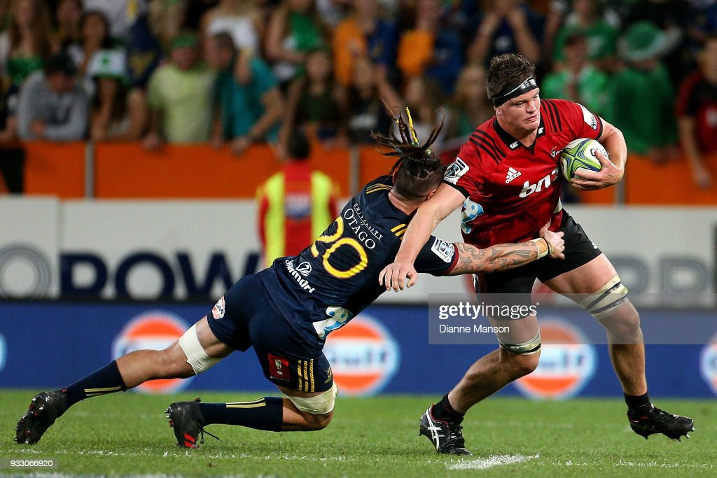 Scott Barrett (R) of the Crusaders is tackled by Elliot Dixon of the Highlanders during the round five Super Rugby match between the Highlanders and the Crusaders at Forsyth Barr Stadium on March 17, 2018 in Dunedin, New Zealand.