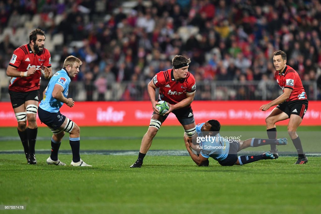 Scott Barrett of the Crusaders is tackled by Kurtley Beale of the Waratahs during the round 12 Super Rugby match between the Crusaders and the Waratahs at AMI Stadium on May 12, 2018 in Christchurch, New Zealand.