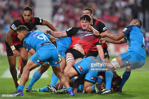 Scott Barrett of the Crusaders is tackled during the round four Super Rugby match between the Crusaders and the Blues at AMI Stadium on March 17 2017...