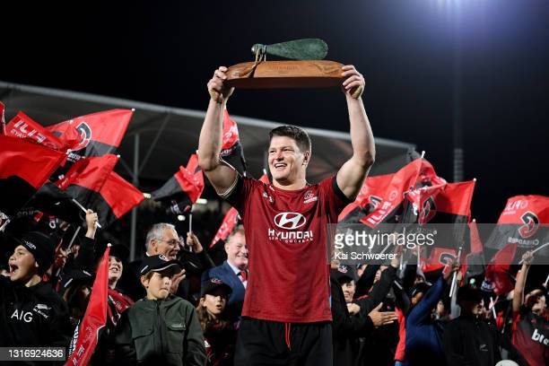Scott Barrett of the Crusaders lifts the trophy following the Super Rugby Aotearoa Final match between the Crusaders and the Chiefs at Orangetheory...
