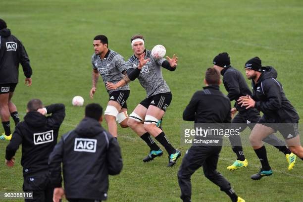 Scott Barrett receives the ball during a New Zealand All Blacks training session at Linwood Rugby Club on May 29 2018 in Christchurch New Zealand