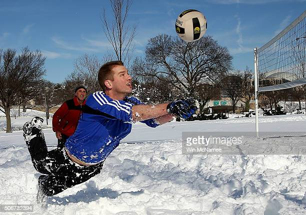 Scott Behrens dives for the ball during a friendly game of volleyball with friends in the snow January 25 2016 in Washington DC Winter Storm Jonas...
