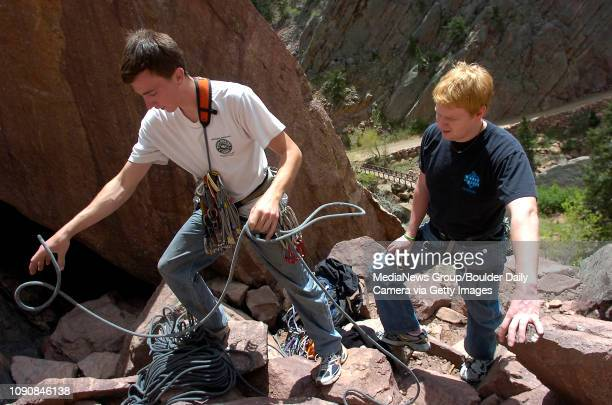 Scott Bennett left of Westminster prepares his gear for climbing while his friend Pete Knowles visiting from Washington DC watches at Eldorado Canyon...