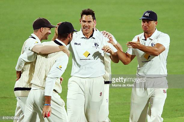 Scott Bloand of the VIC Bushrangers is congratulated by teammates after he got the wicket of Tom Cooper of the Redbacks during day one of the...