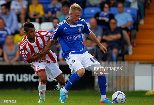 Scott Boden of Macclesfield in action with Ben Glasgow of Stoke City during the Pre Season Friendly match between Macclesfield Town and Stoke City at...