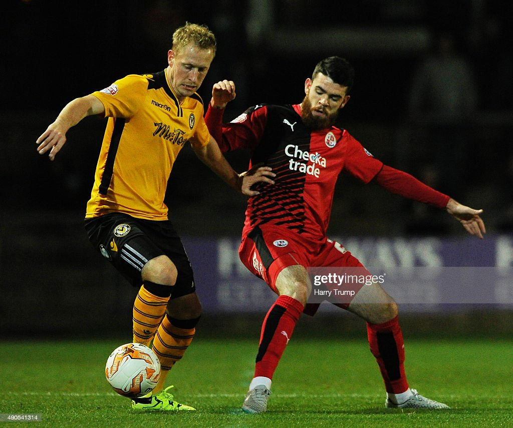 Scott Boden of Newport County is tackled by Liam Donnelly of Crawley Town during the Sky Bet League Two match between Newport County and Crawley Town at Rodney Parade on September 29, 2015 in Newport, Wales.