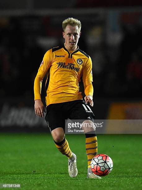 Scott Boden of Newport in action during The Emirates FA Cup First Round Replay match between Newport County and Brackley Town at Rodney Parade on...