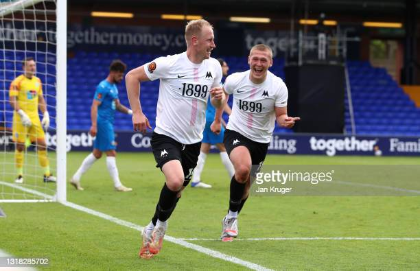 Scott Boden of Torquay United celebrates after scoring their team's second goal with Jake Andrews during the Vanarama National League match between...
