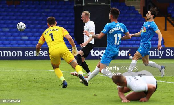 Scott Boden of Torquay United scores their team's second goal past Ben Hinchliffe of Stockport County during the Vanarama National League match...