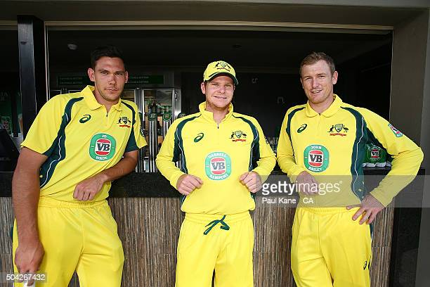 Scott Boland George Bailey and Steven Smith pose while wearing Victoria Bitter ODI series shirts featuring the names of competition winners as part...