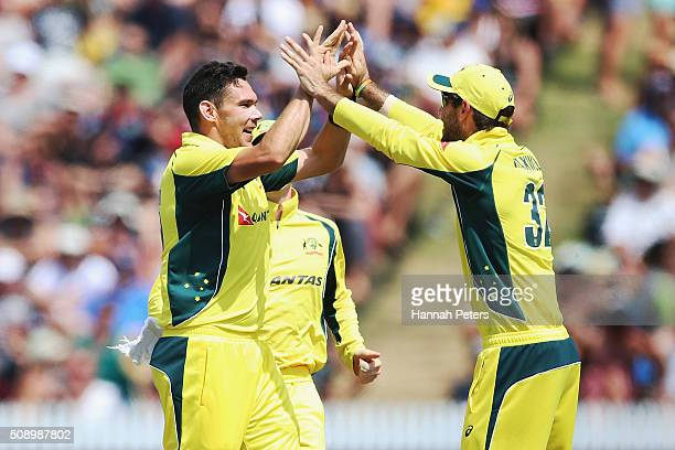 Scott Boland of Australia celebrates the wicket of Kane Williamson of the Black Caps with Mitchell Marsh of Australia during the 3rd One Day...