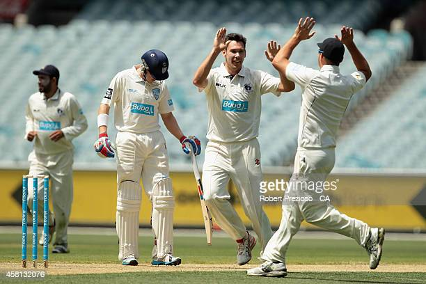 Scott Boland of the Bushrangers celebrates after taking the wicket of Ryan Carters of the Blues during day one of the Sheffield Shield match between...