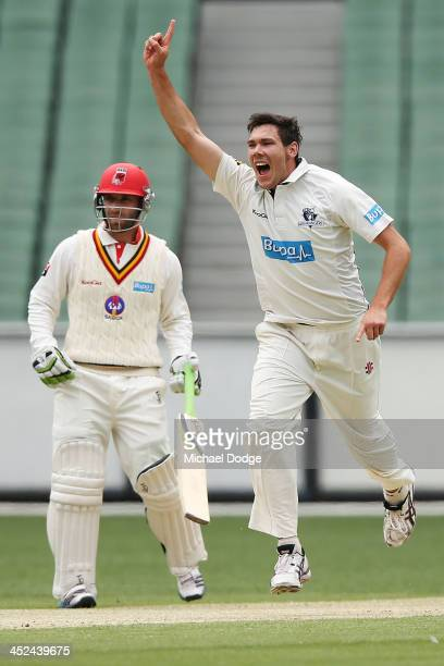 Scott Boland of the Bushrangers celebrates his dismissal of Travis Head of the Redbacks during day one of the Sheffield Shield match between the...
