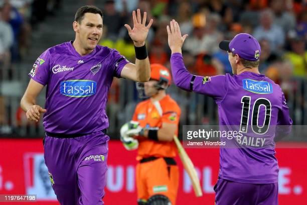 Scott Boland of the Hobart Hurricanes celebrates with his team mates taking his first wicket of the night during the Big Bash League match between...