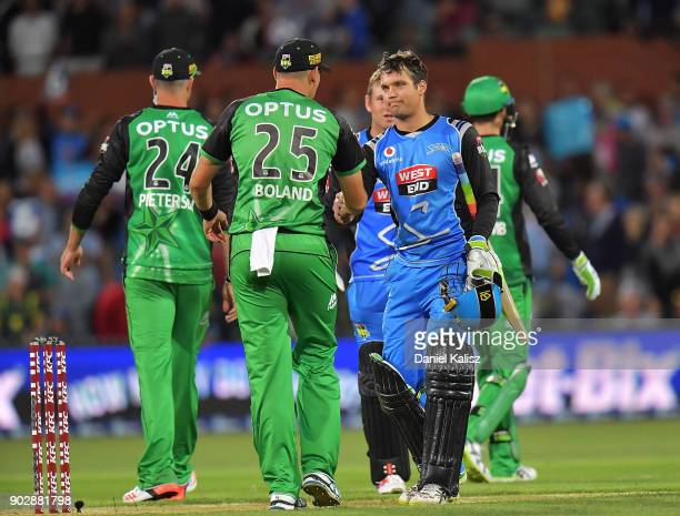 Scott Boland of the Melbourne Stars congratulates Alex Carey of the Adelaide Strikers during the Big Bash League match between the Adelaide Strikers...