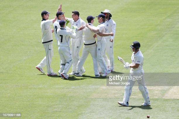 Scott Boland of Victoria celebrates a wicket of D'Arcy Short of Western Australia during day four of the Sheffield Shield match between Victoria and...