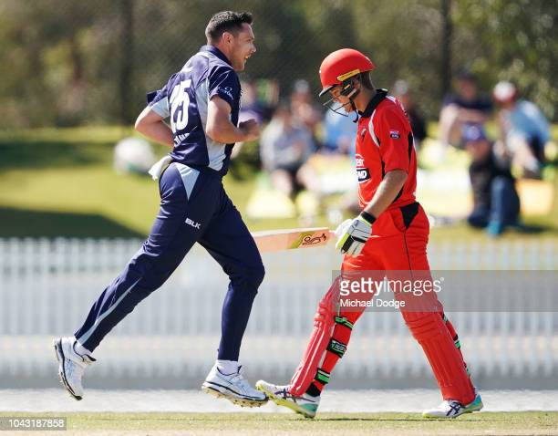 Scott Boland of Victoria celebrates the wicket Alex Carey of South Australia during the JLT One Day Cup match between Victoria and South Australia at...