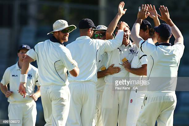 Scott Boland of Victoria is congratulated by team mates after dismissing Michael Hogan of Western Australia and winning the game during day three of...