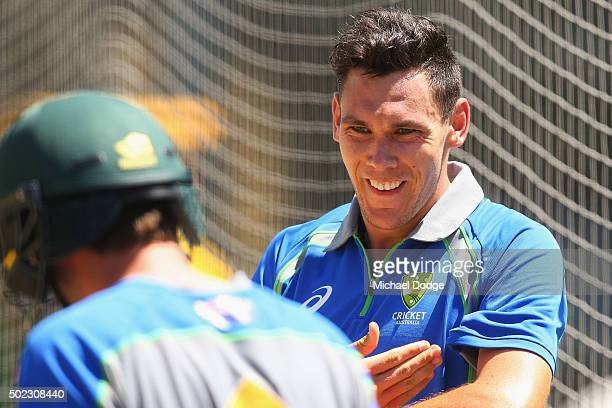 Scott Boland reacts after hitting Joe Burns on the helmet during an Australian nets session at the Melbourne Cricket Ground on December 23, 2015 in...