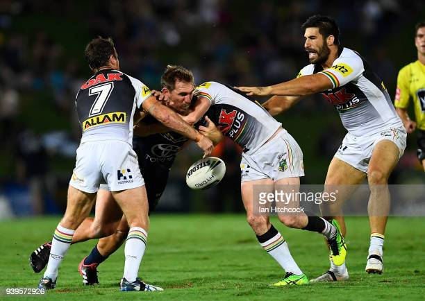 Scott Bolton of the Cowboys drops the ball in a tackle during the round four NRL match between the North Queensland Cowboys and the Penrith Panthers...