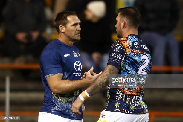 Scott Bolton of the Cowboys is embraced by team mate Kyle Feldt in the warm up during the round 10 NRL match between the Wests Tigers and the North...