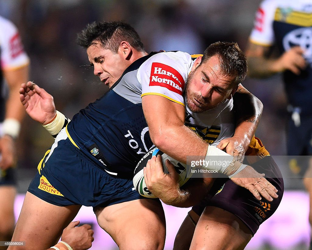Scott Bolton of the Cowboys is tackled by Corey Parker of the Broncos during the NRL 1st Elimination Final match between the North Queensland Cowboys and the Brisbane Broncos at 1300SMILES Stadium on September 13, 2014 in Townsville, Australia.