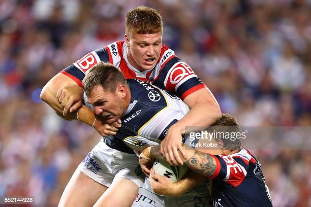 Scott Bolton of the Cowboys is tackled during the NRL Preliminary Final match between the Sydney Roosters and the North Queensland Cowboys at Allianz...