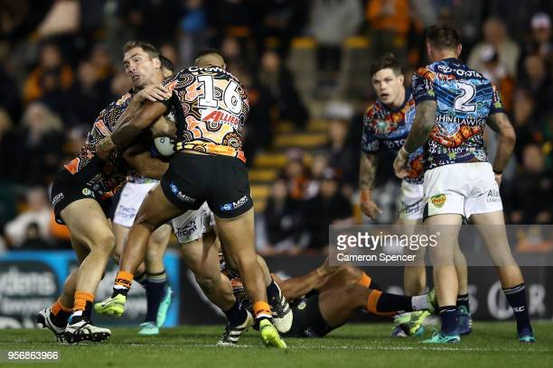 Scott Bolton of the Cowboys is tackled during the round 10 NRL match between the Wests Tigers and the North Queensland Cowboys at Leichhardt Oval on...