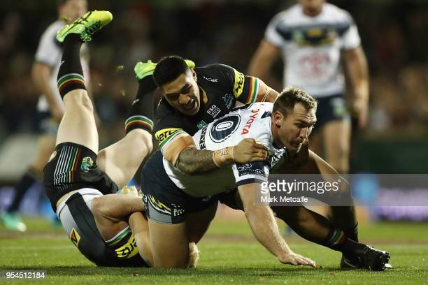 Scott Bolton of the Cowboys is tackled during the round nine NRL match between the Penrith Panthers and the North Queensland Cowboys at Carrington...