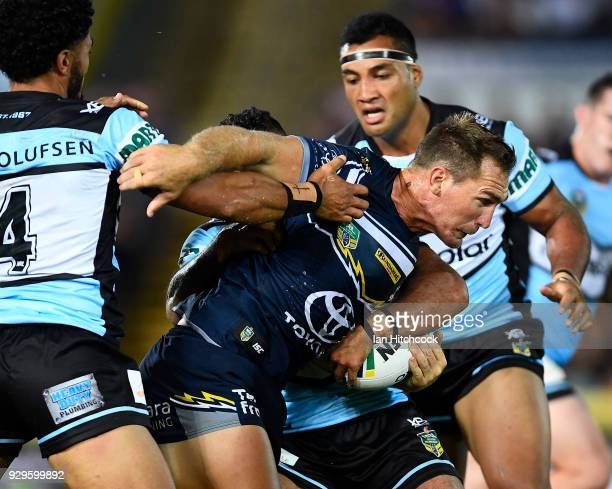 Scott Bolton of the Cowboys is tackled during the round one NRL match between the North Queensland Cowboys and the Cronulla Sharks at 1300SMILES...