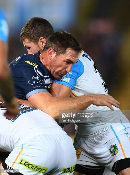 Scott Bolton of the Cowboys is tackled during the round seven NRL match between the North Queensland Cowboys and the Gold Coast Titans at 1300SMILES...