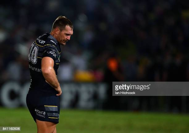 Scott Bolton of the Cowboys looks dejected after losing the round 26 NRL match between the North Queensland Cowboys and the Brisbane Broncos at...