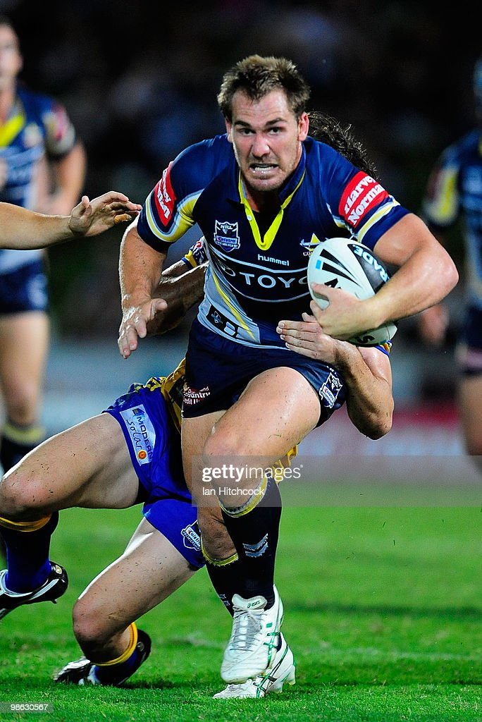 Scott Bolton of the Cowboys looks to get past the tackle of Joel Reddy of the Eels during the round seven NRL match between the North Queensland Cowboys and the Parramatta Eels at Dairy Farmers Stadium on April 23, 2010 in Townsville, Australia.