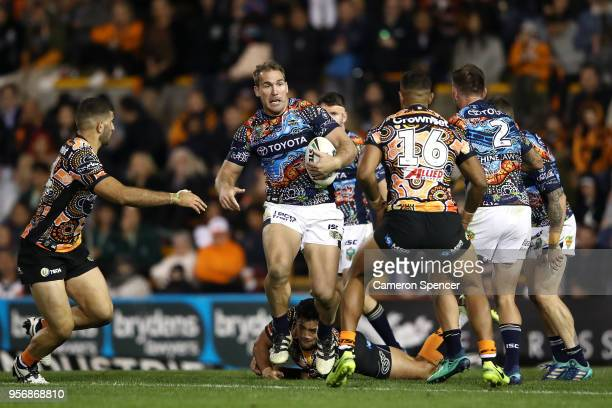 Scott Bolton of the Cowboys runs the ball during the round 10 NRL match between the Wests Tigers and the North Queensland Cowboys at Leichhardt Oval...