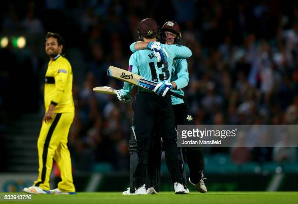 Scott Borthwick and Gareth Batty of Surrey celebrate their victory during the NatWest T20 Blast match between Surrey and Gloucestershire at The Kia...