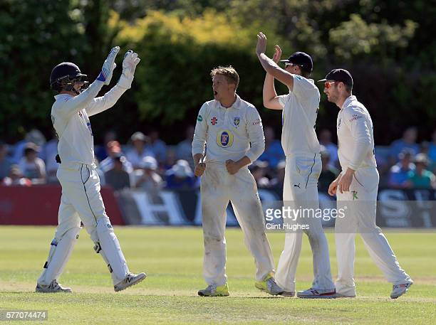 Scott Borthwick of Durham celebrates after he takes the wicket of Lancashire's Tom Moores during day three of the Specsavers County Championship...