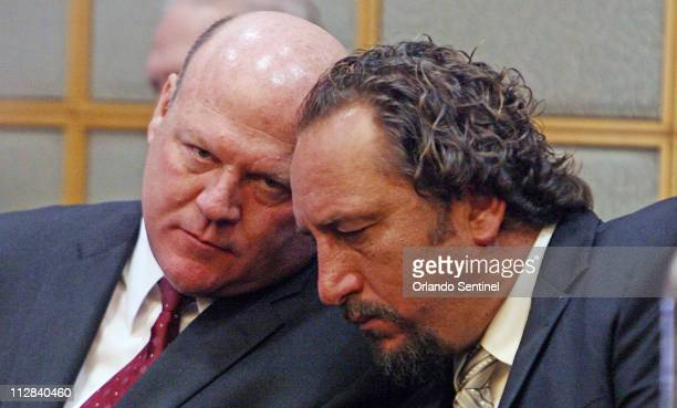Scott Brancheau, right, husband of SeaWorld trainer Dawn Brancheau, talks with attorney Jon Mills, Wednesday, March 24, 2010 during a court hearing...